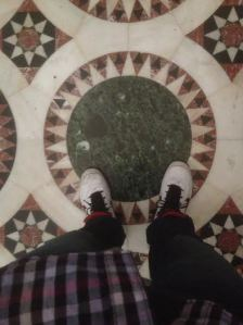 Standing at the supposed center of the world in the Church of the Holy Sepluchur