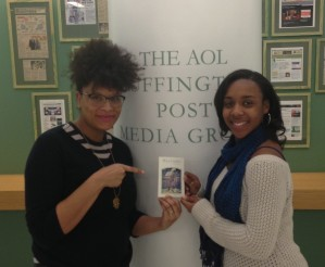 "Julee Wilson and Taylor Griffith holding a picture of ""The Giant"""